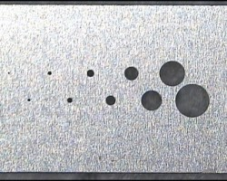 Figure 8 Portion of a Standard FIB Apertures Strip in Molybdenum