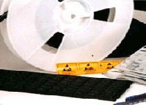 "Figure 11. Die can be ""picked"" from the dicing media and placed on surface mount tape for pick and place tools or placed in die trays"